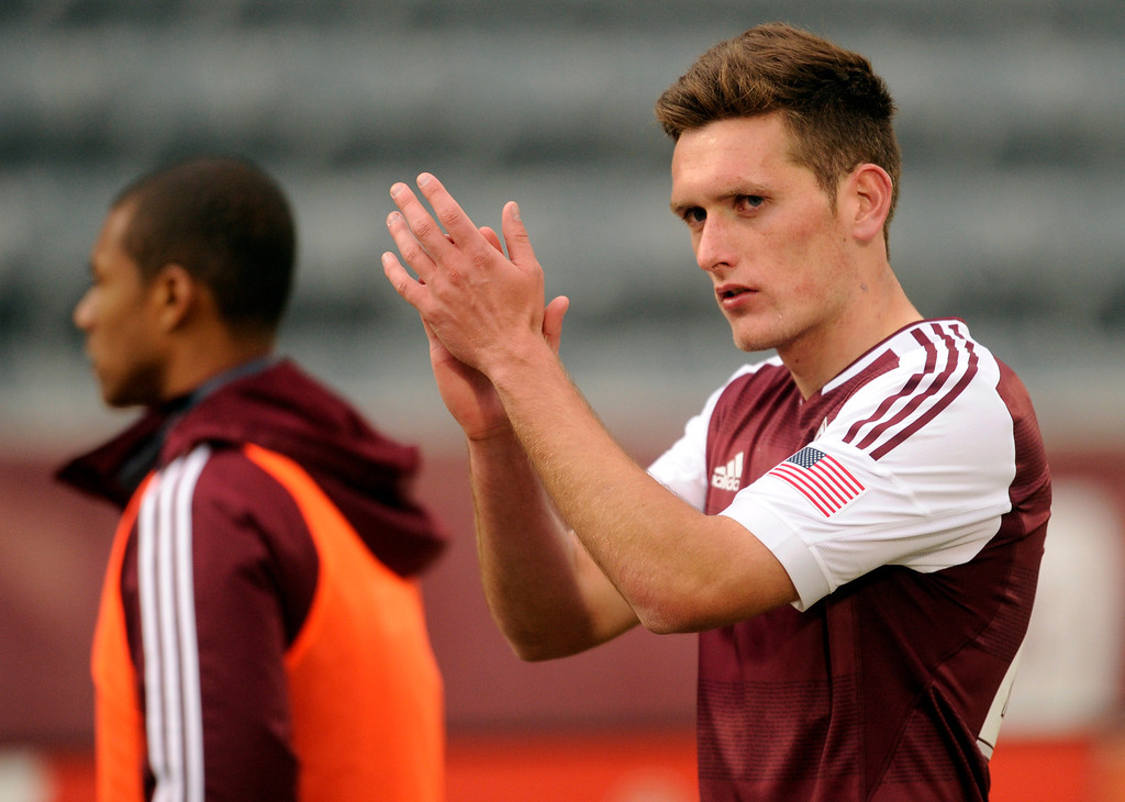 . Rapids defender Shane O\'Neill applauded fans following the game. The Colorado Rapids tied the Portland Timbers 2-2 Saturday, March 30, 2013 at Dick\'s Sporting Goods Park in Commerce City.  Photo By Karl Gehring/The Denver Post)