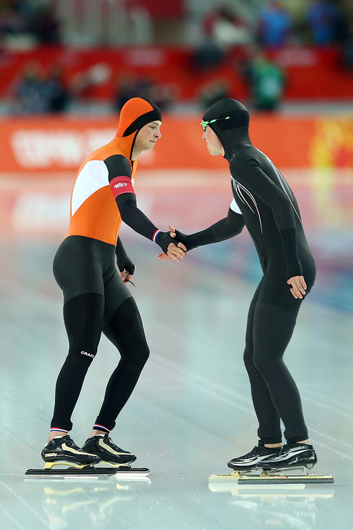 . Sven Kramer (L) of the Netherlands and Jonathan Kuck of the United States shake hands before competing the Men\'s 5000m Speed Skating event during day 1 of the Sochi 2014 Winter Olympics at Adler Arena Skating Center on February 8, 2014 in Sochi, Russia.  (Photo by Paul Gilham/Getty Images)
