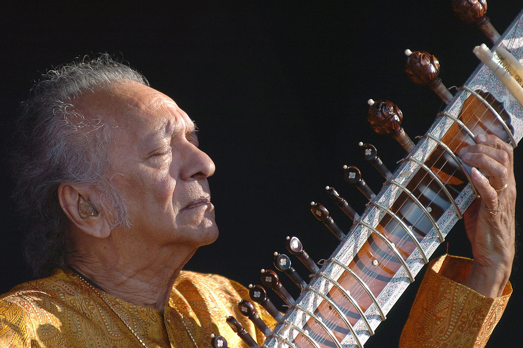 . FILE - In this July 19, 2005 file photo, Indian musician Ravi Shankar performs during the opening day of the Paleo Festival, in Nyon, Switzerland. Shankar, the sitar virtuoso who became a hippie musical icon of the 1960s after hobnobbing with the Beatles and who introduced traditional Indian ragas to Western audiences over an eight-decade career, died Tuesday, Dec. 11, 2012. He was 92. (AP Photo/Keystone, Sandro Campardo, File)