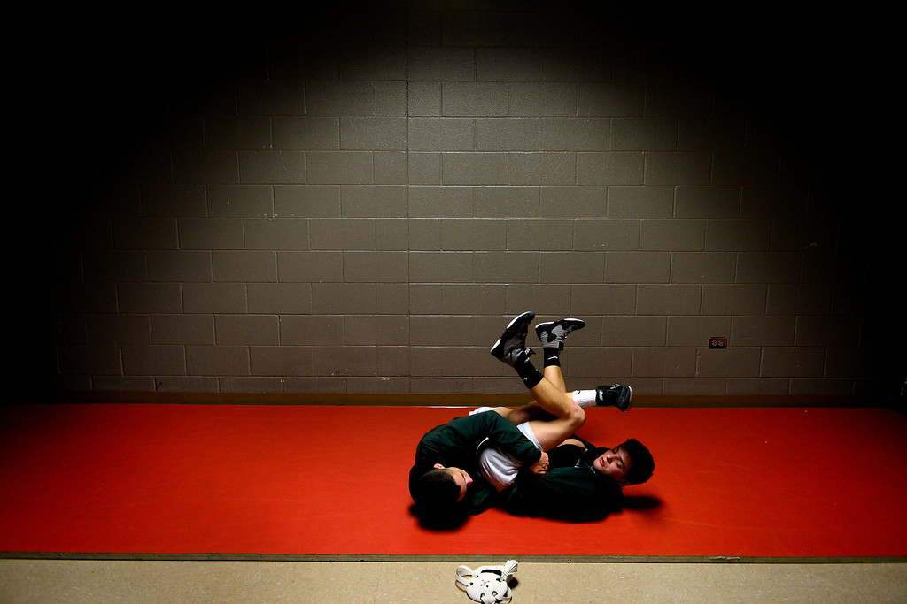 . DENVER, CO - FEBRUARY 21: Niwot 132-pounder Joey Lambert works a tilt on teammate  106-pounder Clayton Robinson during the Colorado State High School Wrestling Championships. The state finals will run through Saturday evening at the Pepsi Center. (Photo by AAron Ontiveroz/The Denver Post)