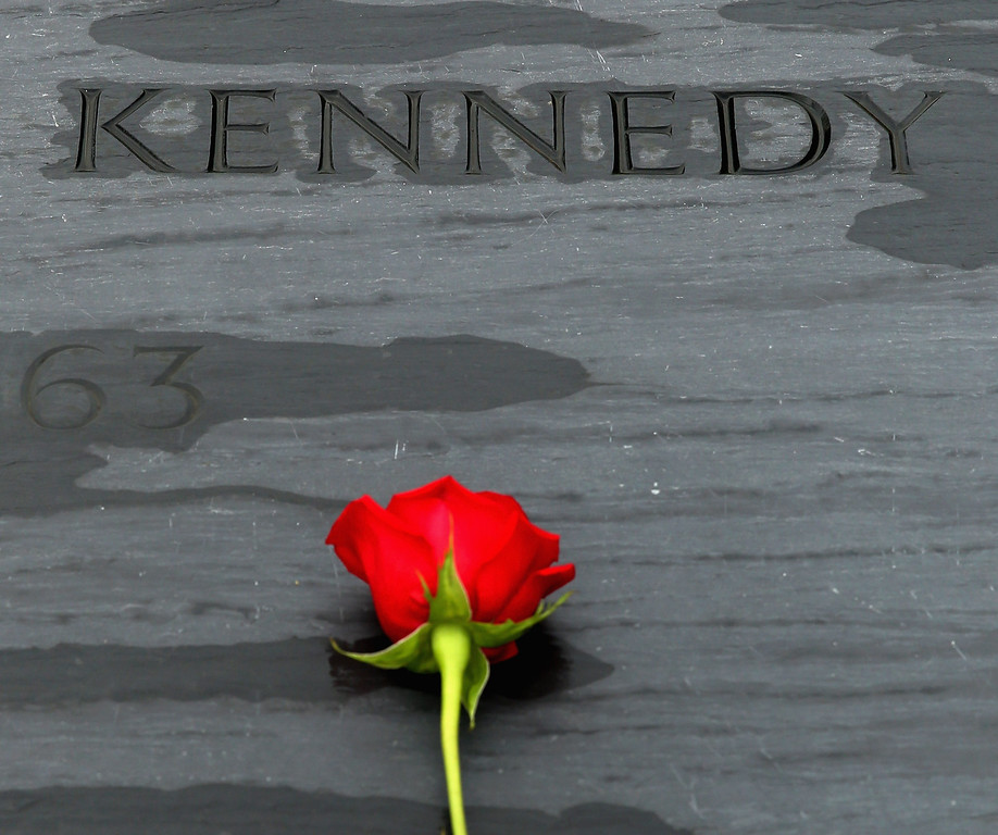 . A rose left by family members sits on top of former U.S. President John F. Kennedy\'s grave marker at Arlington National Cemetery November 22, 2013 in Arlington, Virginia. Remembrance ceremonies will be held across the United States today, the 50th anniversary of the assassination of President Kennedy.  (Photo by Chip Somodevilla/Getty Images)