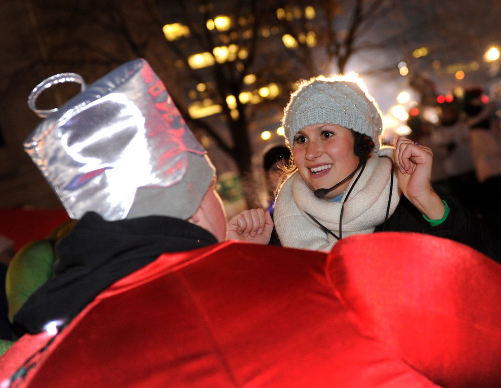 . DENVER, CO. - DECEMBER 06: Lauren Zink, right, helped Decklan Rilling, left, with his costume as the 9News Parade of Lights kicked off Friday night, December 6, 2013. The weather for the parade was clear but temperatures dipped below zero. Photo By Karl Gehring/The Denver Post