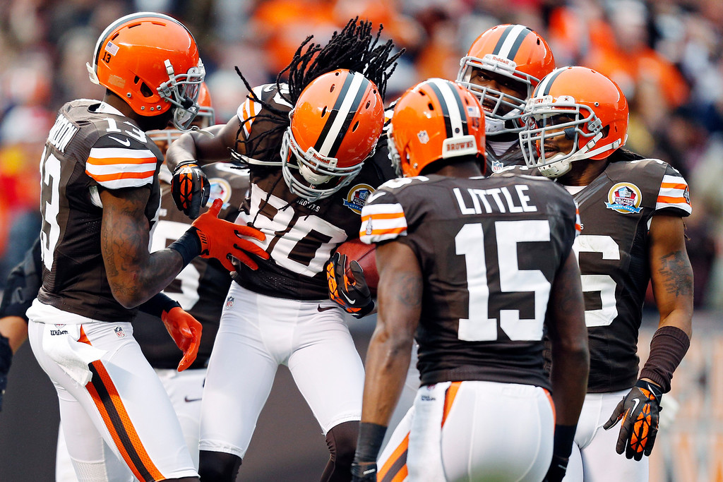 . Cleveland Browns wide receiver Travis Benjamin (80) is congratulated by teammates after a 93-yard punt return for a touchdown in the second quarter of an NFL football game against the Kansas City Chiefs in Cleveland, Sunday, Dec. 9, 2012. (AP Photo/Rick Osentoski)