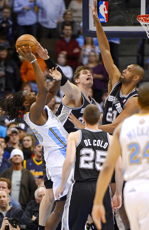 . The Denver Nuggets Kenneth Faried (35) gets his shot blocked by San Antonio Spurs Tiago Splitter (22) during the first quarter April 10, 2013 at Pepsi Center. (Photo By John Leyba/The Denver Post)