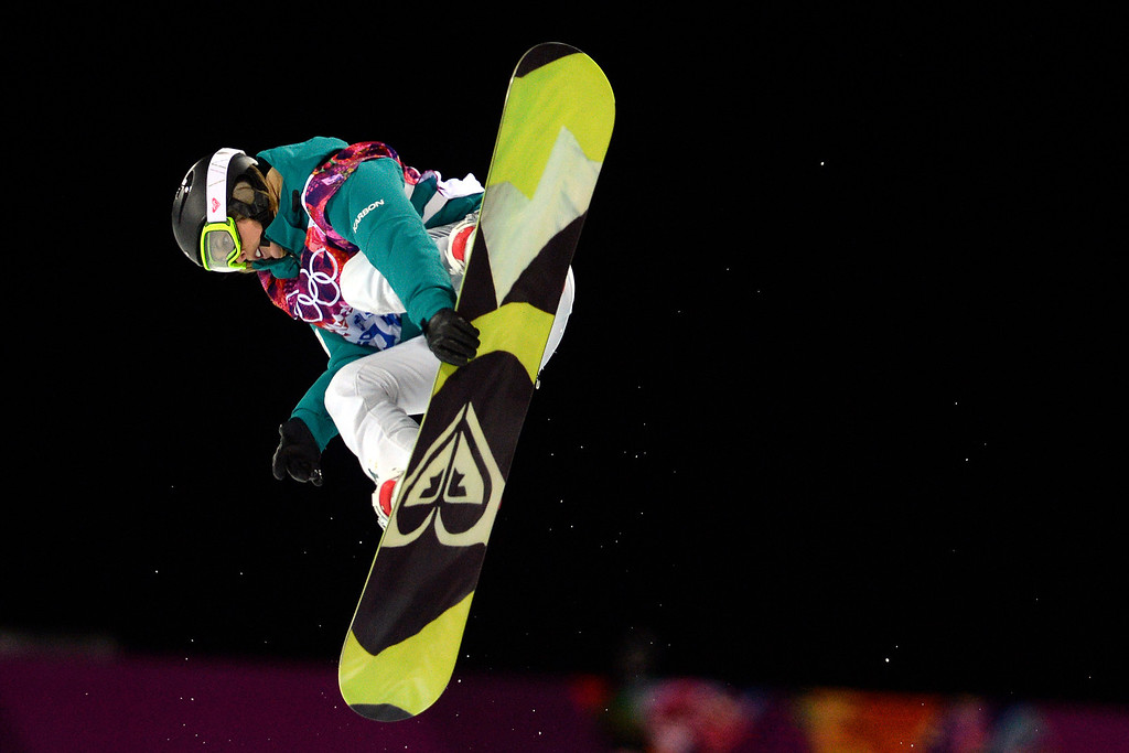 . Australia\'s Torah Bright makes a grab during a women\'s snowboard halfpipe final at the Rosa Khutor Extreme Park. Sochi 2014 Winter Olympics on Wednesday, February 12, 2014. (Photo by AAron Ontiveroz/The Denver Post)