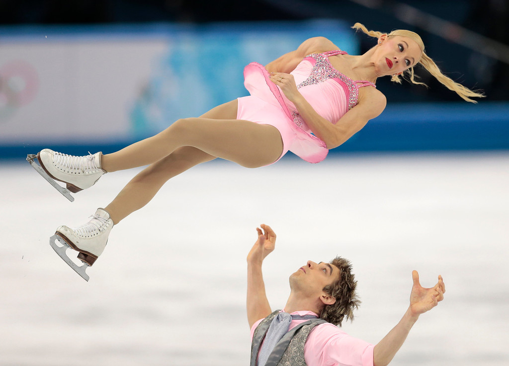 Description of . Stacey Kemp and David King of Britain compete in the pairs short program figure skating competition at the Iceberg Skating Palace during the 2014 Winter Olympics, Tuesday, Feb. 11, 2014, in Sochi, Russia. (AP Photo/Ivan Sekretarev)