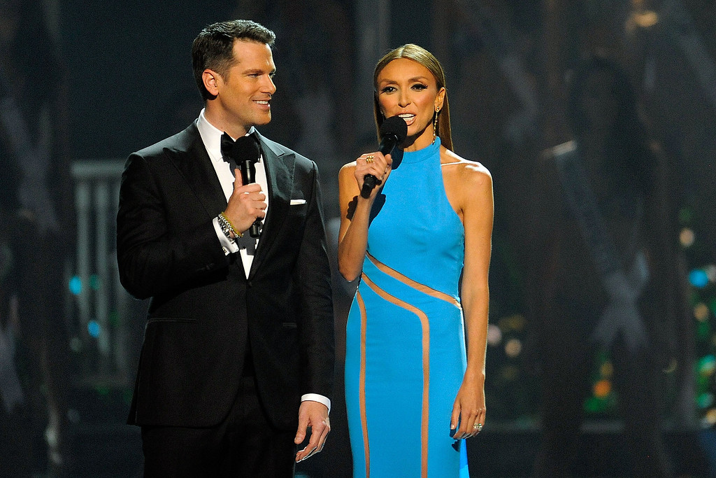 . Hosts Thomas Roberts (L) and Giuliana Rancic (R) introduce contestants during the 2014 Miss USA Competition at The Baton Rouge River Center on June 8, 2014 in Baton Rouge, Louisiana.  (Photo by Stacy Revere/Getty Images)