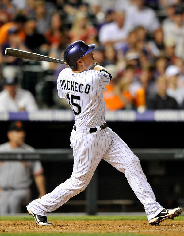 . Colorado Rockies\' Jordan Pacheco watches the flight of a grand slam ball hit off San Francisco Giants starting pitcher Madison Bumgarner during the fifth inning of a baseball game on Friday, May 17, 2013, in Denver. (AP Photo/Jack Dempsey)