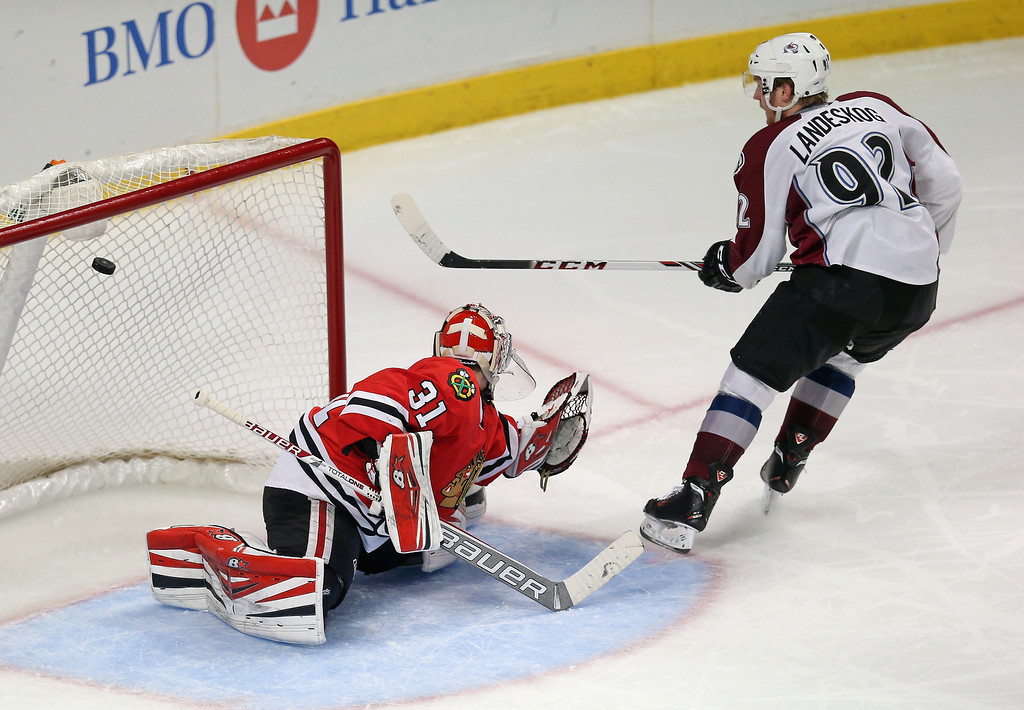. CHICAGO, IL - DECEMBER 27: Gabriel Landeskog #92 of the Colorado Avalanche scores a goal in the third period over Antti Raanta #31 of the Chicago Blackhawks at the United Center on December 27, 2013 in Chicago, Illinois. The Blackhawks defeated the Avalanche 7-2. (Photo by Jonathan Daniel/Getty Images)