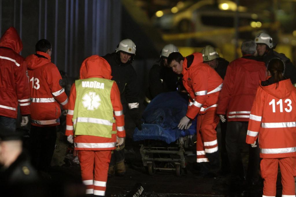 . Paramedics remove a corpse from the rubble of Maxima supermarket in Riga, Latvia, 23 November 2013.   EPA/VALDA KALNINA