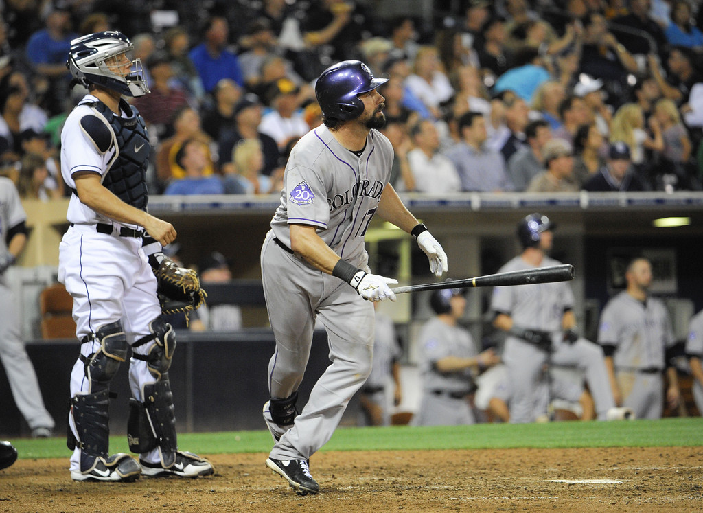. SAN DIEGO, CA - SEPTEMBER 6:  Todd Helton #17 of the Colorado Rockies and Nick Hundley #4 of the San Diego Padres watch the flight of Helton\'s solo home run during the ninth inning of a baseball game at Petco Park on September 6, 2013 in San Diego, California.  (Photo by Denis Poroy/Getty Images)