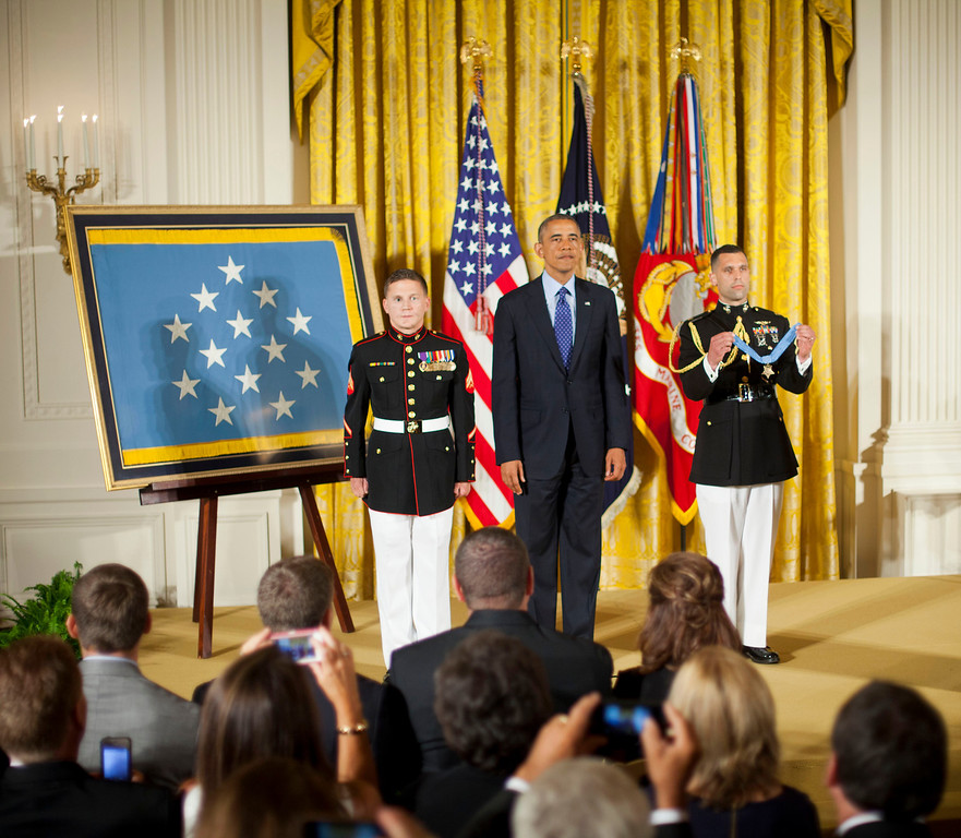 """. President Barack Obama stands with retired Marine Cpl. William \""""Kyle\"""" Carpenter, left, before awarding him the Medal of Honor, Thursday, June 19, 2014, in the East Room of the White House in Washington.  (AP Photo/Pablo Martinez Monsivais)"""