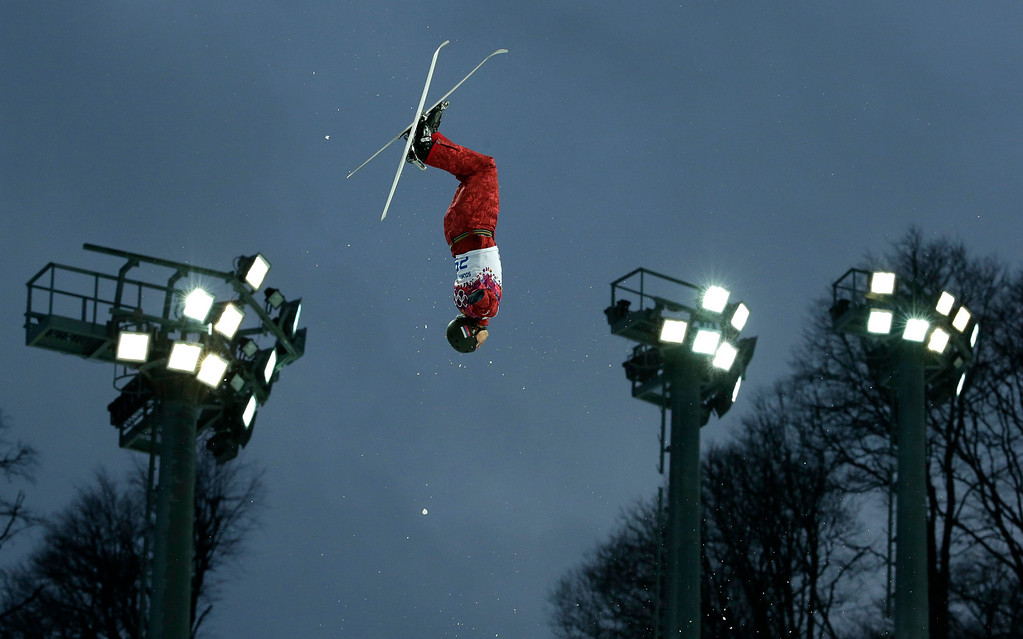 . Russia\'s Timofei Slivets jumps during men\'s freestyle skiing aerials qualifying at the Rosa Khutor Extreme Park, at the 2014 Winter Olympics, Monday, Feb. 17, 2014, in Krasnaya Polyana, Russia.(AP Photo/Andy Wong)