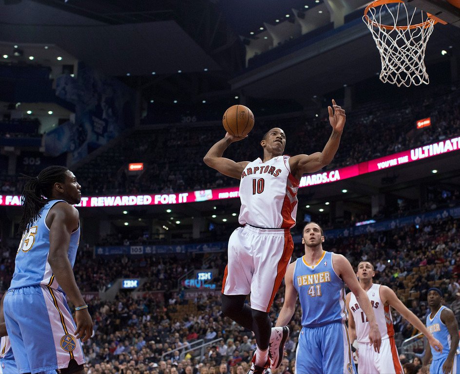 . Toronto Raptors\' DeMar DeRozan goes up for a dunk against the Denver Nuggets during the first half of an NBA basketball game in Toronto on Tuesday, Feb. 12, 2013. (AP Photo/The Canadian Press, Chris Young)