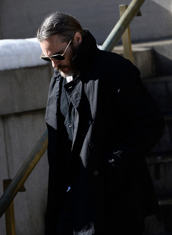 . US actor Joaquin Phoenix leaves the Funeral Mass for US Actor Phillip Seymour Hoffan at St Ignatius Church in New York, New York, USA 07 February 2014. Hoffman, 46, died 02 February from a suspected drug overdose.  EPA/ANDREW GOMBERT
