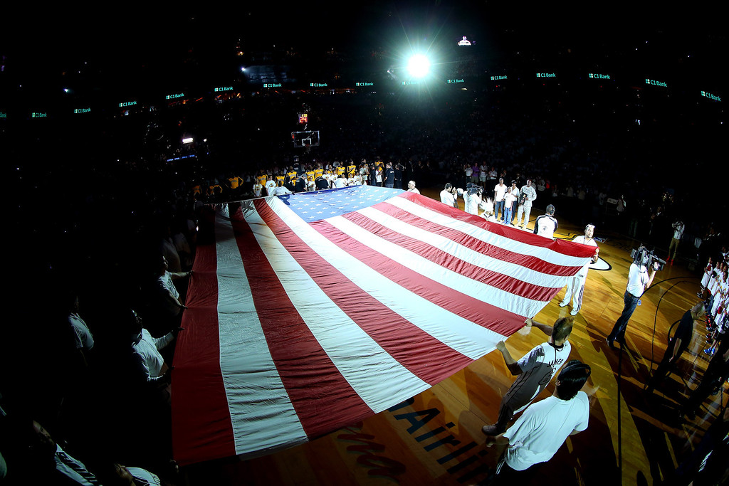 . An American flag is spread over the court prior to Game Four of the Eastern Conference Finals of the 2014 NBA Playoffs between the Miami Heat and the Indiana Pacers at American Airlines Arena on May 26, 2014 in Miami, Florida.  (Photo by Mike Ehrmann/Getty Images)