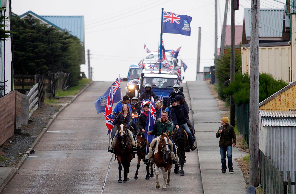 . Falkland islanders lead a parade on their horses in Stanley, March 10, 2013. Voters in the remote British-ruled Falkland Islands hold a referendum on their future today that seeks to challenge Argentina\'s increasingly vocal sovereignty claim. REUTERS/Marcos Brindicci