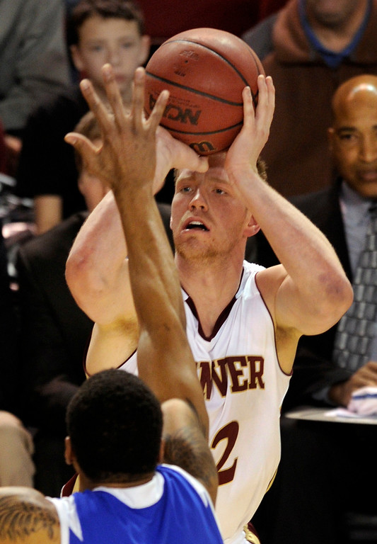. Denver senior Chase Hallam (32) put up a shot past Bulldogs defender Brandon Gibson (2) in the second half. The University of Denver men\'s basketball team defeated the Louisiana Tech Bulldogs 78-54 at Magness Arena Saturday night, March 9, 2013. (Photo By Karl Gehring/The Denver Post)