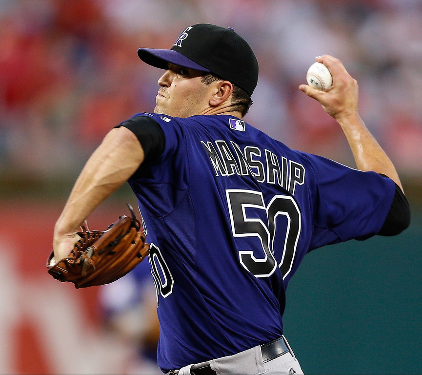 . Starting pitcher Jeff Manship #50 of the Colorado Rockies throws a pitch during the game against the Philadelphia Phillies at Citizens Bank Park on August 19, 2013 in Philadelphia, Pennsylvania. (Photo by Brian Garfinkel/Getty Images)