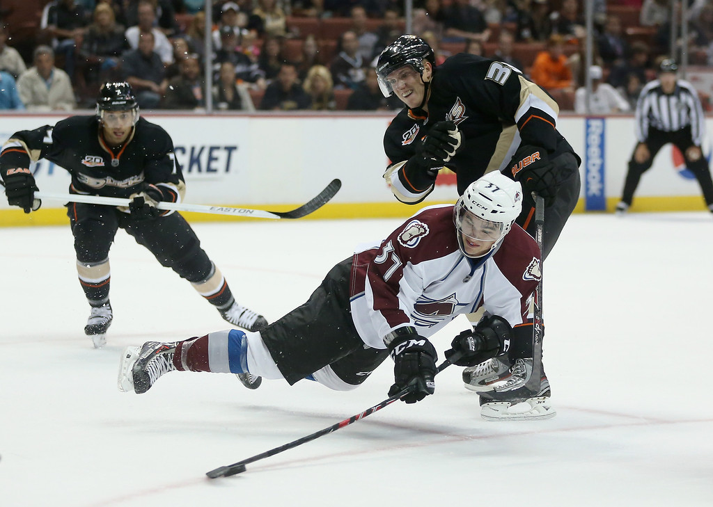 . Colin Smith #37 of the Colorado Avalanche dives for the puck in front of Jakob Silfverberg #33 of the Anaheim Ducks in the first period at Honda Center on September 22, 2013 in Anaheim, California.  (Photo by Jeff Gross/Getty Images)