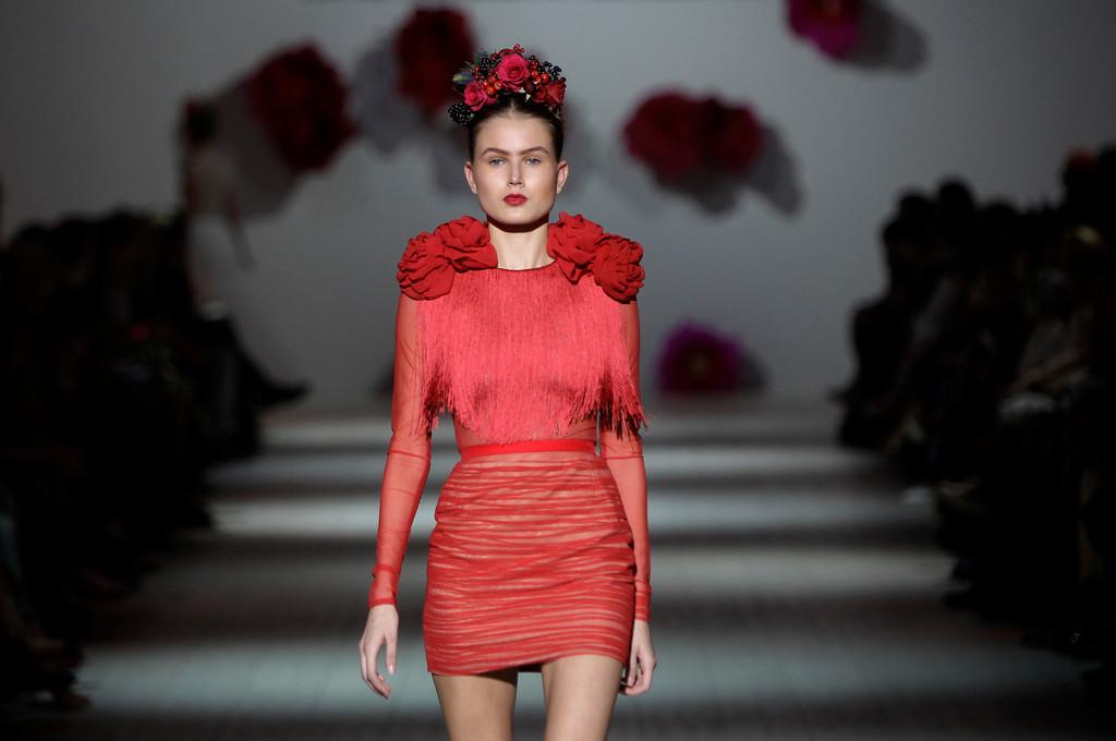 . A model displays outfits by Georgian designer Anouki Bicholla during Ukraine Fashion Week in Kiev, Ukraine, Sunday, Oct. 13, 2013. (AP Photo/Sergei Chuzavkov)