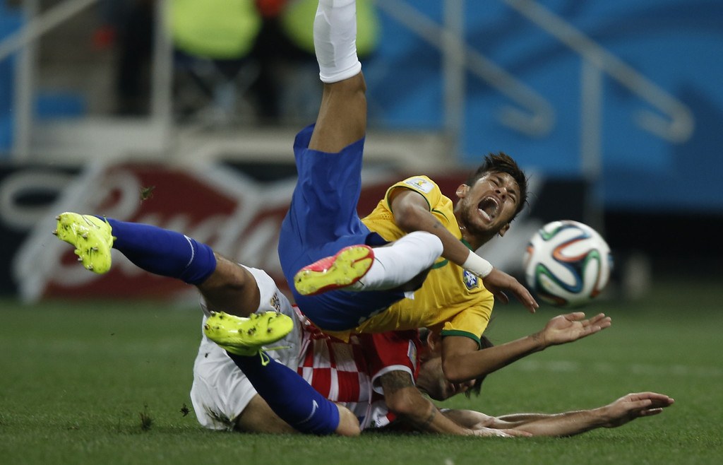. Brazil\'s forward Neymar (R) is fouled by Croatia\'s defender Vedran Corluka during a Group A football match between Brazil and Croatia at the Corinthians Arena in Sao Paulo during the 2014 FIFA World Cup on June 12, 2014. AFP PHOTO / ADRIAN DENNIS/AFP/Getty Images
