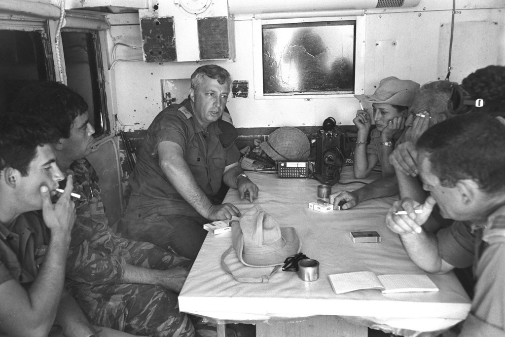 . ISRAEL - MAY 29, 1967: Israeli army\'s Southern Command General Ariel Sharon (2nd L) meets with his officers a week before the June 5 start of the Six-Day War May 29, 1967 at their headquarters somewhere in southern Israel. Thirty-eight years after Israel captured the Gaza Strip from the Egyptians during the campaign, the Jewish state looks poised to leave the populous Palestinian territory as the now Prime Minister Ariel Sharon\'s disengagement plan approaches its August 15, 2005 implementation. (Photo by Micha Han/GPO via Getty Images)