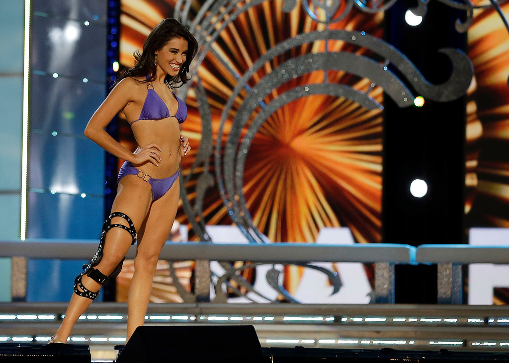 . Miss Florida Myrrhanda Jones wears a swimsuit during the lifestyle competition during the Miss America 2014 pageant, Sunday, Sept. 15, 2013, in Atlantic City, N.J. (AP Photo/Mel Evans)