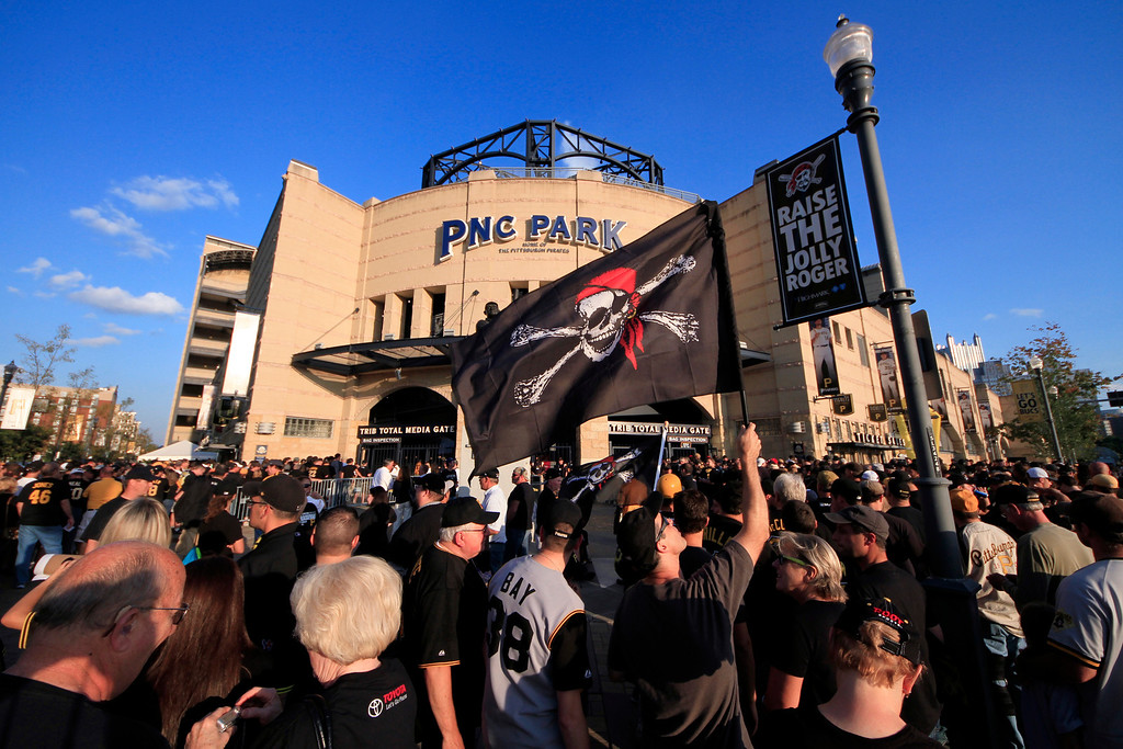 . Pittsburgh Pirates fans wait for the gates to open before the NL wild-card playoff baseball game between the Pirates and the Cincinnati Reds in Pittsburgh on Tuesday, Oct. 1, 2013. The Pirates made the playoffs for the first time since 1992. (AP Photo/Gene J. Puskar)