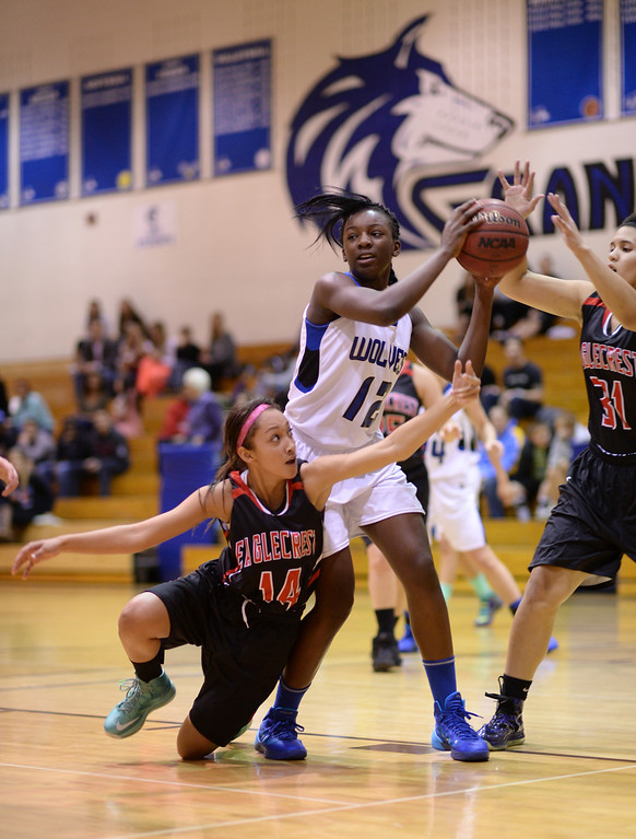 . AURORA, CO. JANUARY 08: Michaela Onyenwere of Grandview High School (12), center, controls the offensive rebound between Brijohnna Williams (14), left, and Charissa Johnson (31) of Eaglecrest High School at Grandview High School in Aurora, Colorado January 8, 2014. Grandview won 69-22. (Photo by Hyoung Chang/The Denver Post)