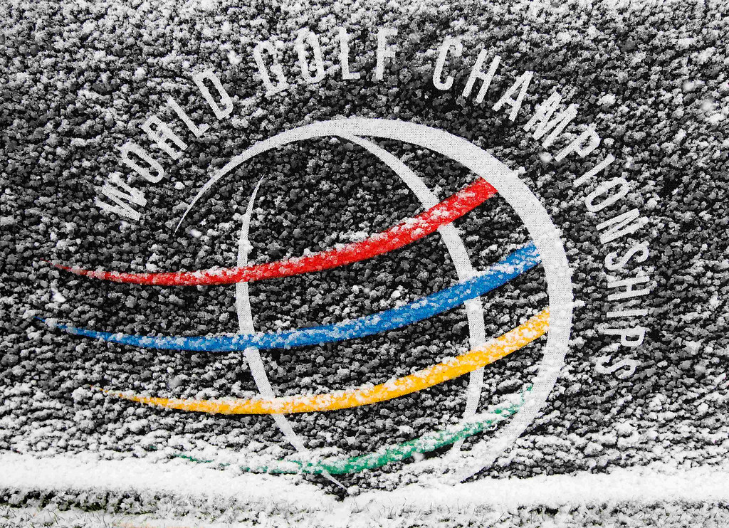 . A World Golf Championship sign is covered in snow after play was suspended during the first round of the WGC-Accenture Match Play Championship golf tournament in Marana, Arizona February 20, 2013. Play was suspended at 1807 GMT because of driving rain and snow in the opening round of the WGC-Accenture Match Play Championship on Wednesday. REUTERS/Matt Sullivan