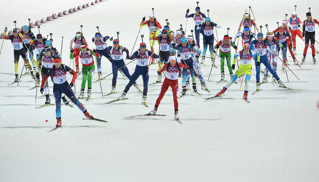 . Athletes compete at the start of the Women\'s Biathlon 12,5 km Mass Start at the Laura Cross-Country Ski and Biathlon Center during the Sochi Winter Olympics on February 17, 2014, in Rosa Kuthor, near Sochi. AFP PHOTO / ALBERTO PIZZOLI/AFP/Getty Images