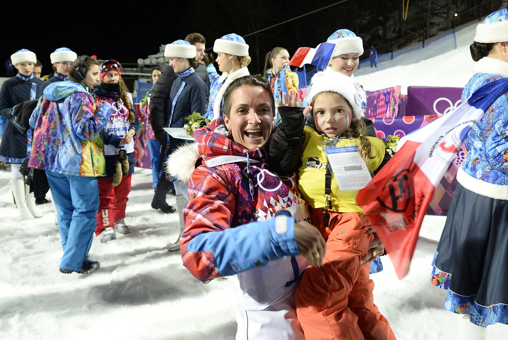 . Silver Medallist, France\'s Marie Martinod celebrates with daughter Melirose in the Women\'s Freestyle Skiing Halfpipe finals at the Rosa Khutor Extreme Park during the Sochi Winter Olympics on February 20, 2014.        AFP PHOTO / FRANCK FIFE/AFP/Getty Images