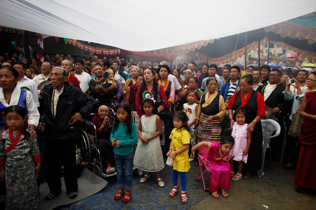 . Young Tibetans join elders during celebrations to mark the birthday of their spiritual leader the Dalai Lama in Katmandu, Nepal, Saturday, July 6, 2013. The Tibetan leader turned 78 today. (AP Photo/Niranjan Shrestha)