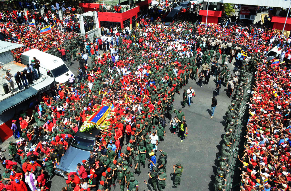 . Thousands of supporters accompany the hearse carrying the coffin of Venezuelan President Hugo Chavez while leaving the Military Hospital to the Military Academy, on March 6, 2013, in Caracas.  AFP PHOTO/Luis CAMACHO/AFP/Getty Images
