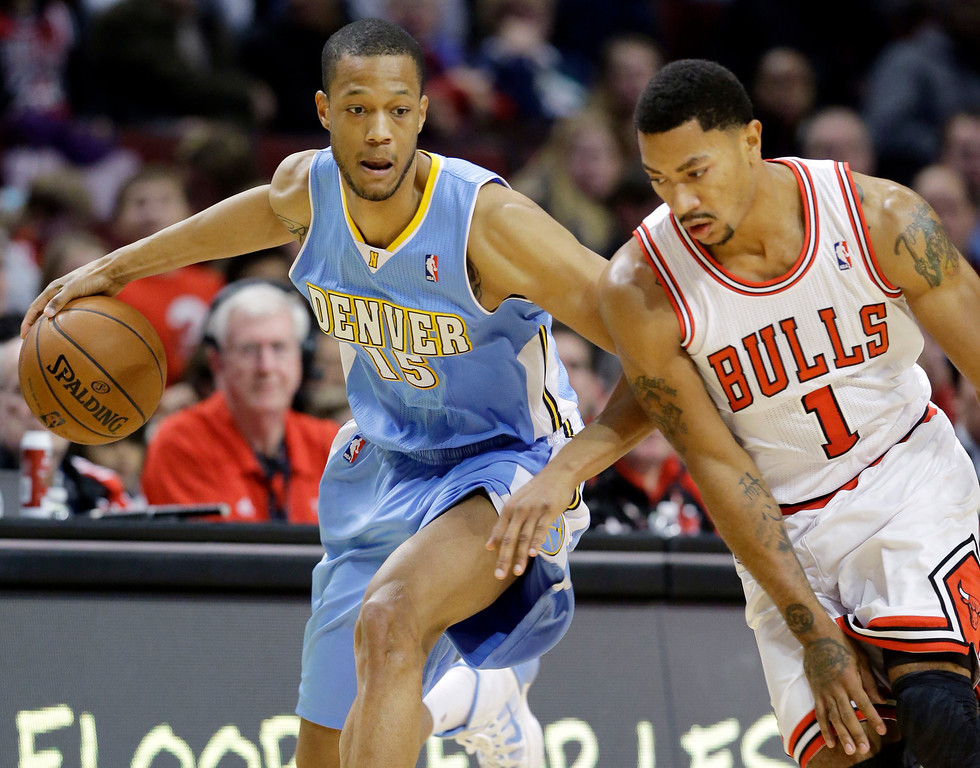 . Denver Nuggets forward Anthony Randolph (15) steals the ball from Chicago Bulls guard Derrick Rose during the first half of an NBA preseason basketball game in Chicago on Friday, Oct. 25, 2013. (AP Photo/Nam Y. Huh)