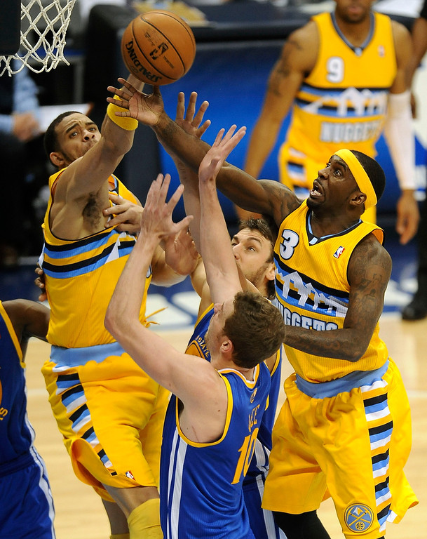 . DENVER, CO. - APRIL 20: Denver Nuggets guard Ty Lawson (3) goes high for a rebound in the second quarter. The Denver Nuggets took on the Golden State Warriors in Game 1 of the Western Conference First Round Series at the Pepsi Center in Denver, Colo. on April 20, 2013. (Photo by Steve Nehf/The Denver Post)