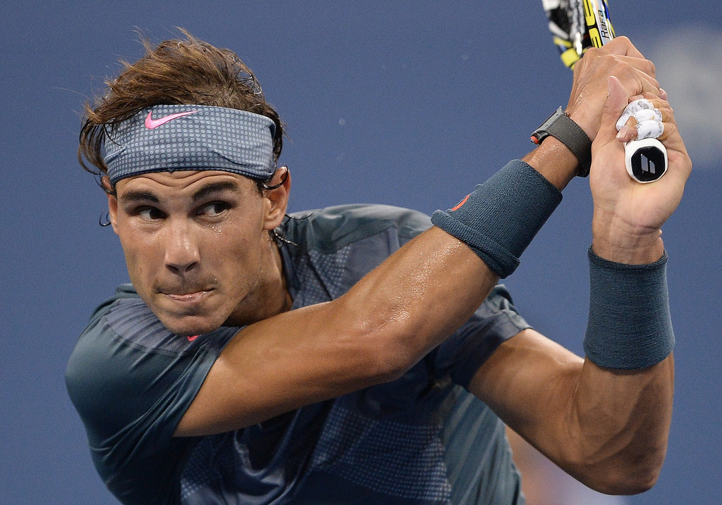 . Spanish tennis player Rafael Nadal plays a point against Brazil\'s Rogerio Dutra Silva during their 2013 US Open men\'s singles match at the USTA Billie Jean King National Tennis Center in New York on August 29, 2013. EMMANUEL DUNAND/AFP/Getty Images