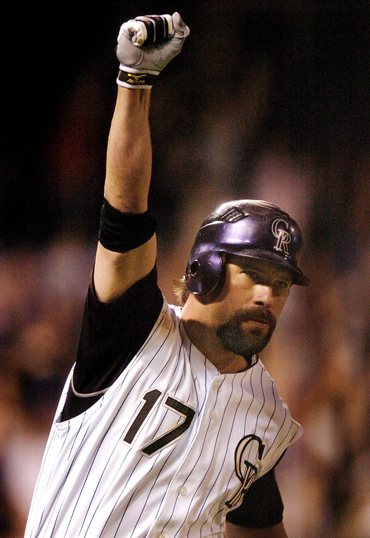 . Todd Helton pumped his fist in the air after watching his ninth-inning homer clear the fence to win the game Tuesday night.  The Colorado Rockies beat the Los Angeles Dodgers 9-8 in September 2007 at Coors Field in the second game of a doubleheader. The Rockies won both games.  The Dodgers are in town for a four-game series.   Karl Gehring/The Denver Post