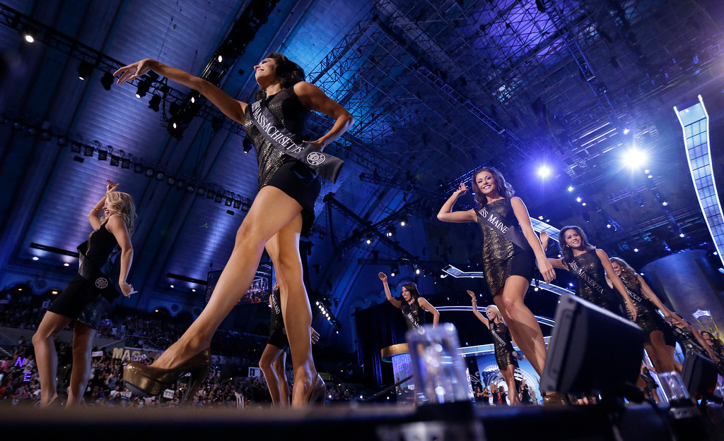 . Contestants walk on the runway during the Miss America 2014 pageant, Sunday, Sept. 15, 2013, in Atlantic City, N.J. (AP Photo/Julio Cortez)