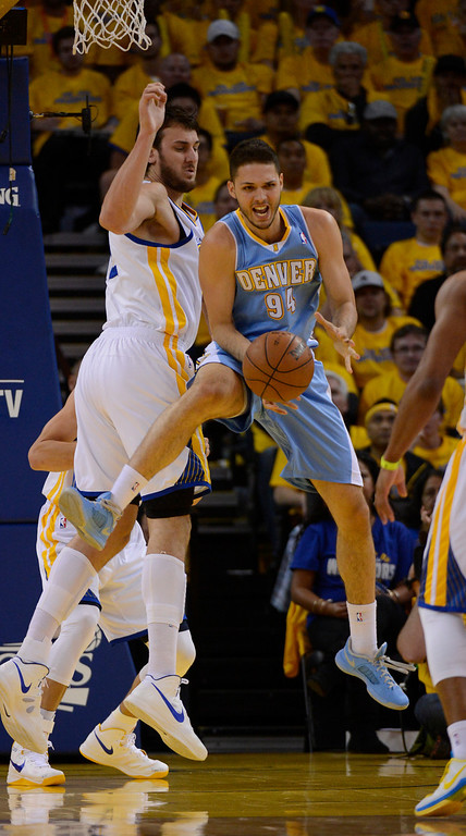 . OAKLAND, CA. - APRIL 26: Evan Fournier (94) of the Denver Nuggets loses the ball as Andrew Bogut (12) of the Golden State Warriors defends on the play in game 3 of the first round of the NBA Playoffs April 26, 2013 at Oracle Arena.  (Photo By John Leyba/The Denver Post)