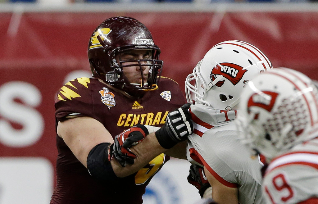 . Central Michigan offensive linesman Eric Fisher (79) goes up against Western Kentucky during the second half of the Little Caesars Pizza Bowl NCAA college football game at Ford Field in Detroit, Wednesday, Dec. 26, 2012. (AP Photo/Carlos Osorio)