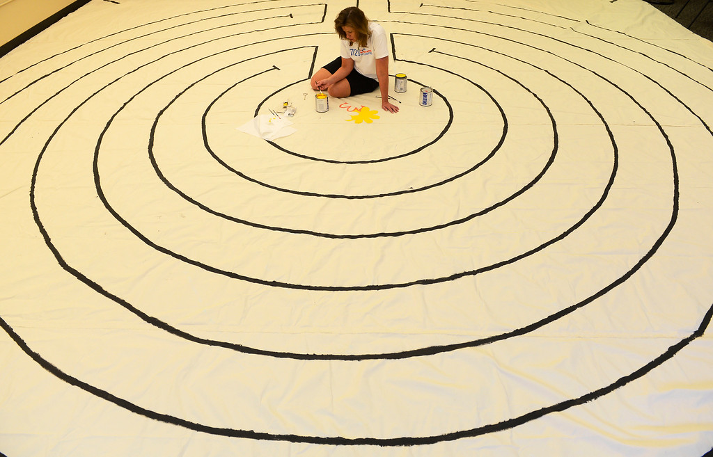. AURORA, CO - JULY 20:  Volunteer, Deanna Schroder, begins the painting of a labyrinth as part of volunteer service projects associated with the 7/20 Day of Remembrance 2013 at the Aurora Strong Resilience Center in Aurora Saturday morning, July 20, 2013. Over 200 people attended an earlier service at the Aurora Municipal Center service in honor of the 12 people killed and over 60 people injured in last years Aurora theater shooting. The memorial service, marking the one-year anniversary of the tragic shooting,  included prayer, songs and speeches from local officials and the Governor of Colorado, John Hickenlooper. (Photo By Andy Cross/The Denver Post)