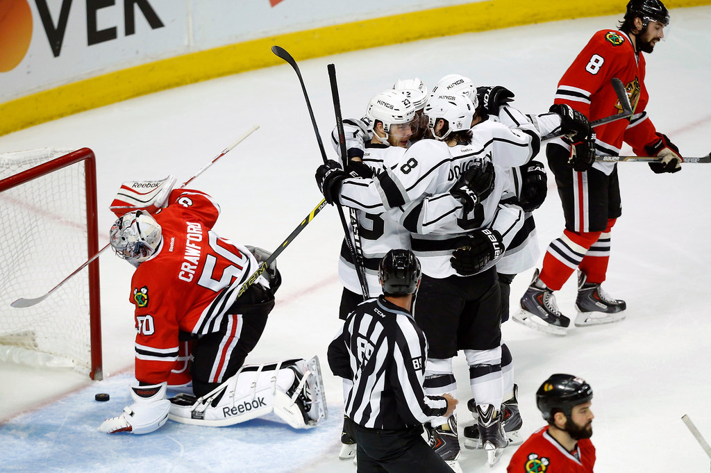 . Los Angeles Kings right wing Dustin Brown (23) celebrates with his teammates after scoring a goal against Chicago Blackhawks goalie Corey Crawford (50) during the second period in Game 5 of the Western Conference finals in the NHL hockey Stanley Cup playoffs Wednesday, May 28, 2014, in Chicago. (AP Photo/Andrew A. Nelles)