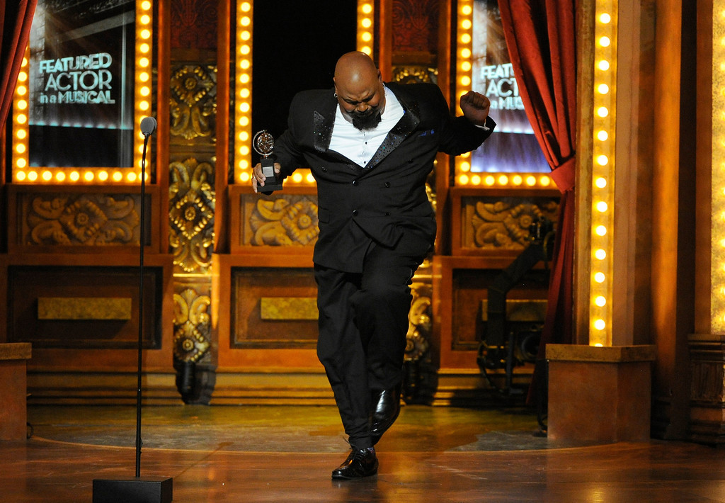 """. James Monroe Iglehart accepts the award for best performance by an actor in a featured role in a musical for \""""Aladdin\"""" at the 68th annual Tony Awards at Radio City Music Hall on Sunday, June 8, 2014, in New York. (Photo by Evan Agostini/Invision/AP)"""