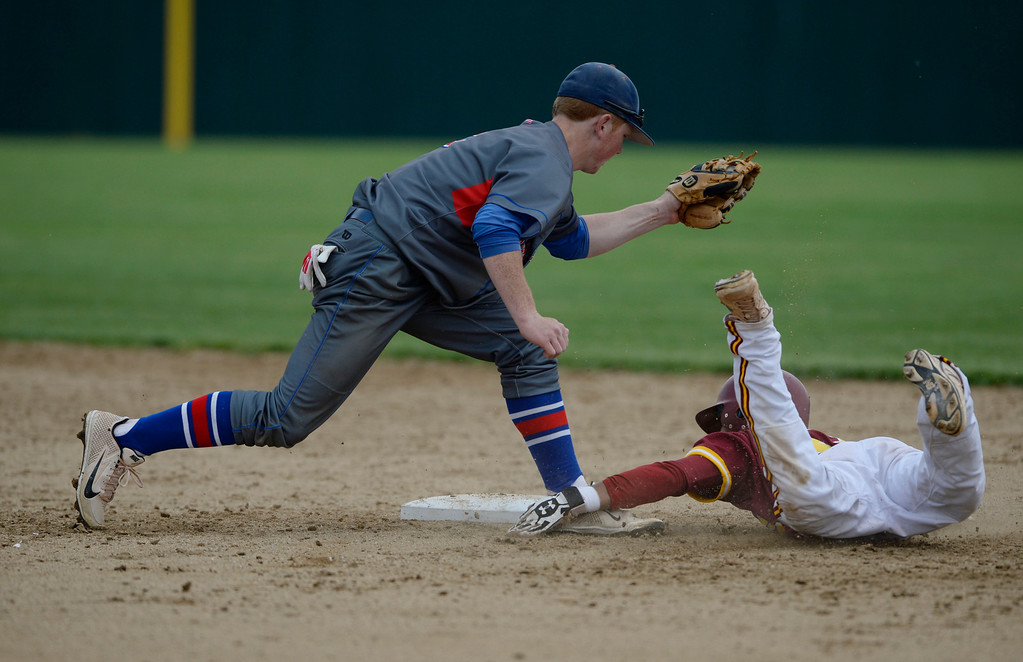 . DENVER, CO. - MAY 23: Cherry Creek infielder, Ryan Robb, tags out Dean Lawson, Rocky Mountain on a steal at second base during the Colorado State 5A baseball playoffs at All City Field Friday afternoon, May 23, 2014. (Photo By Andy Cross / The Denver Post)