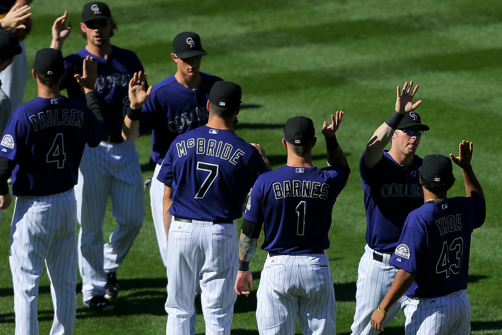 . DENVER, CO - SEPTEMBER 3:  Corey Dickerson #6 of the Colorado Rockies (second from right) celebrates the 9-2 win against the San Francisco Giants with his teammates  at Coors Field on September 3, 2014 in Denver, Colorado. The Rockies defeated the Giants 9-2. (Photo by Justin Edmonds/Getty Images)