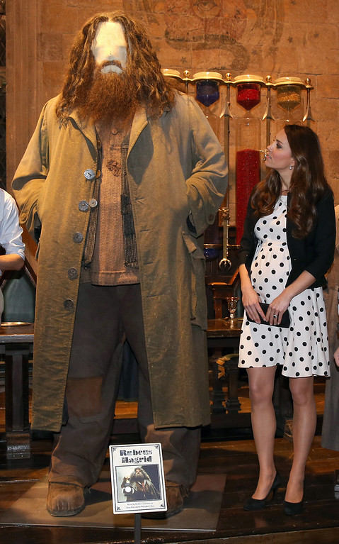 """. Britain\'s Kate the Duchess of Cambridge looks at the costume for the character Hagrid in the Harry Potter films as she and her husband Prince William and his brother Prince Harry, not pictured, attend the inauguration of \""""Warner Bros. Studios Leavesden\"""" near Watford, approximately 18 miles north west of central London, Friday, April 26, 2013. (AP Photo/Chris Jackson, Pool)"""