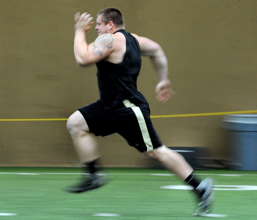 . Eric Richter runs one of his 40-yard dashes  on Wednesday. Scouts from around the NFL  tested and watched University of Colorado football players during CU pro timing day on Wednesday. (Cliff Grassmick/Boulder Daily Camera)