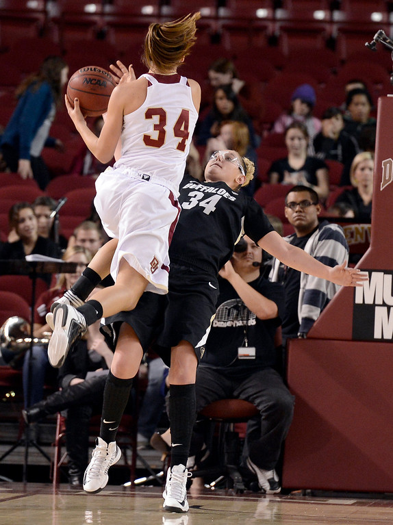 . University of Colorado\'s Jen Reese plays defense on Theresa Wirth during a games against the University of Denver on Tuesday, Dec. 11, at the Magnus Arena on the DU campus in Denver.   (Jeremy Papasso/Daily Camera)